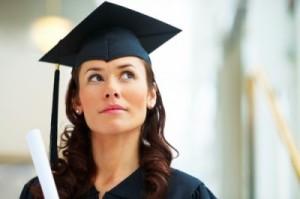 College grad -cap & gown pondering